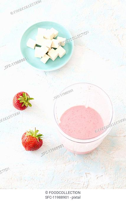 Vegan strawberry smoothie with soya milk and silk tofu
