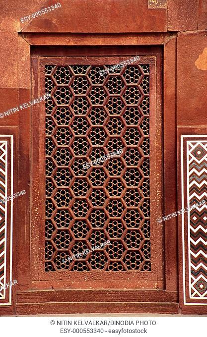Red sand stone carved Jali on gate of Taj Mahal , Agra , Uttar Pradesh , India