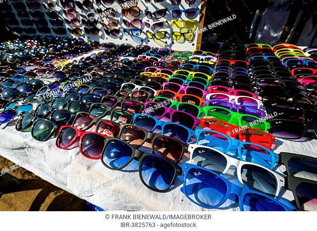 Colourful sunglasses for sale at the weekly flea market, Anjuna, Goa, India