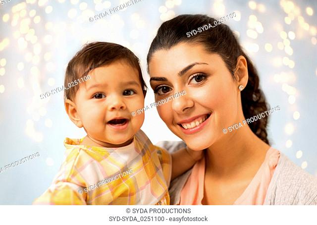 portrait of happy mother with baby daughter