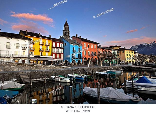 Lakefront in Ascona, Ticino, Switzerland in the evening in the foreground with the old port