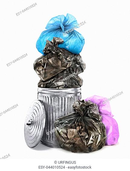 Concept of pollution. Garbage bags inside and around trash container isolated on white background