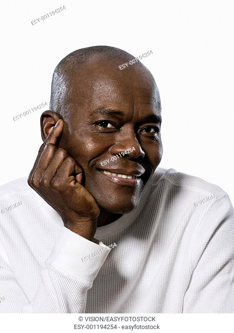 Close-up portrait of a smiling afro American man in studio on white isolated background
