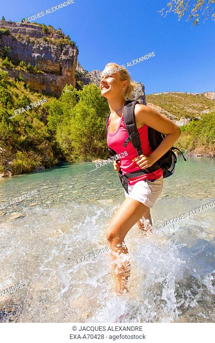Woman hiking in river
