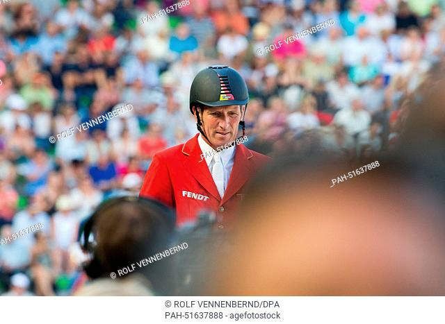 "Rider Ludger Beerbaum of Germany on horse """"Chiara 222"""" reacts in the Show Jumping competition during the World Equestrian Games 2014 in Caen, France"