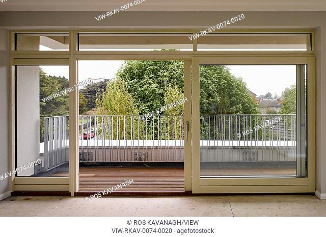 Interior view sliding glass doors showing balcony. Rathmines Crescent, Rathmines, Ireland. Architect: Dubliin City Architects, 2016