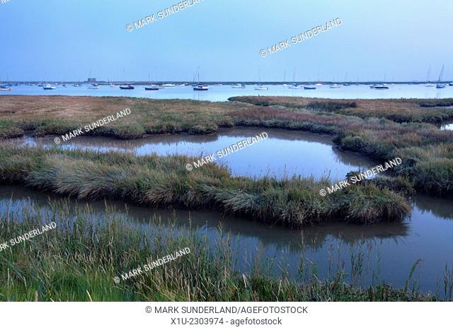 View over the Alde Estuary from Aldeburgh Marshes to the Martello Tower at Dusk Suffolk England
