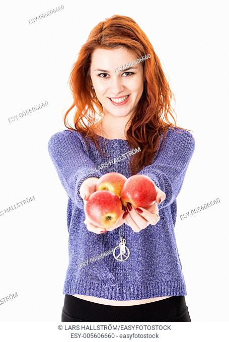 Beautiful woman holding fresh apples