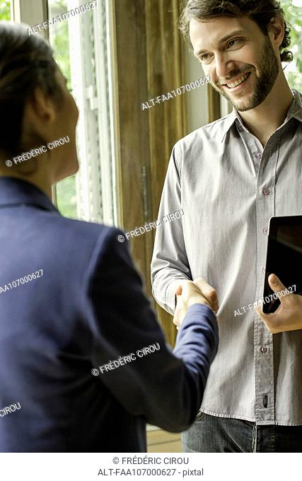 Client shaking hands with sales person