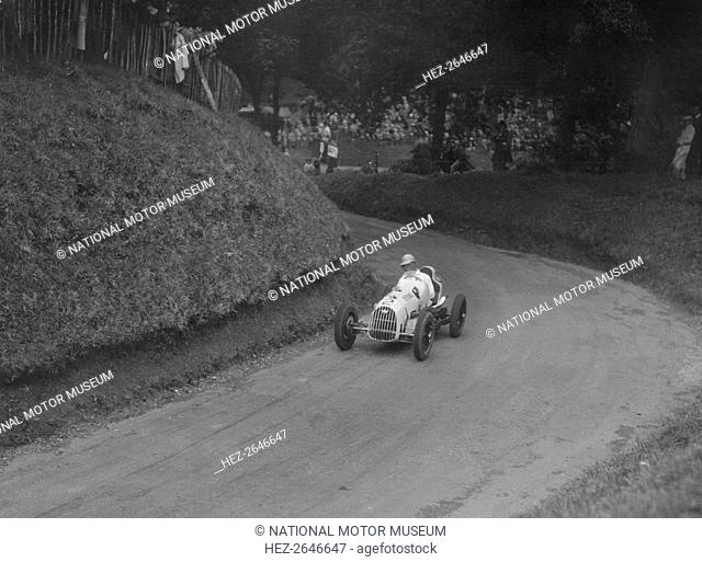 Austin 7 of LP Driscoll competing in the MAC Shelsley Walsh Speed Hill Climb, Worcestershire, 1935. Artist: Bill Brunell