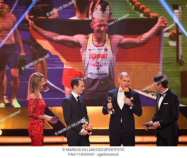 left to right Presenter Katrin Möller-Hohenstein, Eric Frenzel (Second Sportsman of the Year, Nordic Combined), Arthur Abele (Third Sportsman of the Year