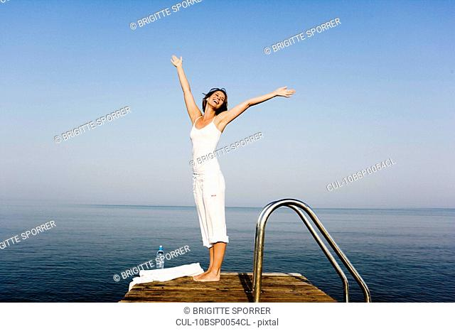 Woman having fun on a pier