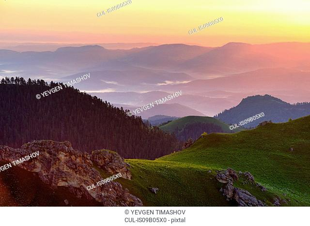 Landscape with mist at dusk, Bolshoy Thach (Big Thach) Nature Park, Caucasian Mountains, Republic of Adygea, Russia