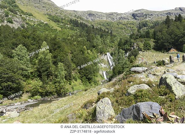Landscape of mountains and waterfall Sauth deth Pish in Aran valley Lleida Catalonia Spain