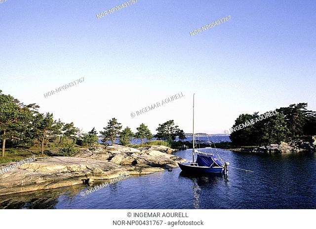 Small island with boat in the water