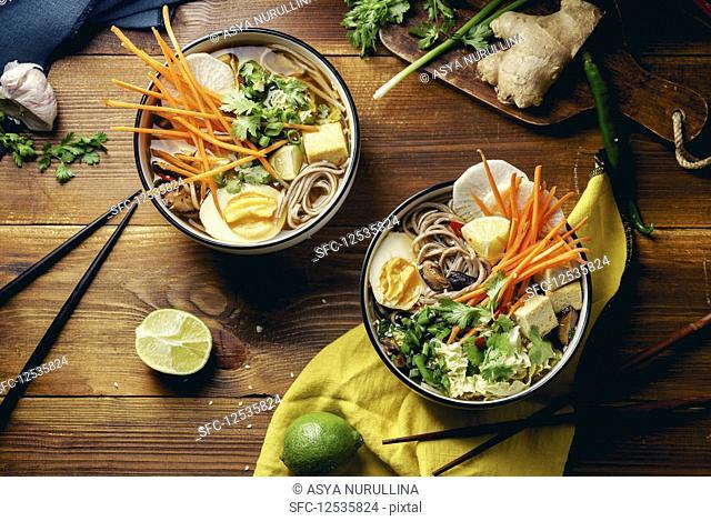 Vegan miso ramen with shiitake mushrooms, fried tofu, carrot, cabbage, leek and lime (Asia)