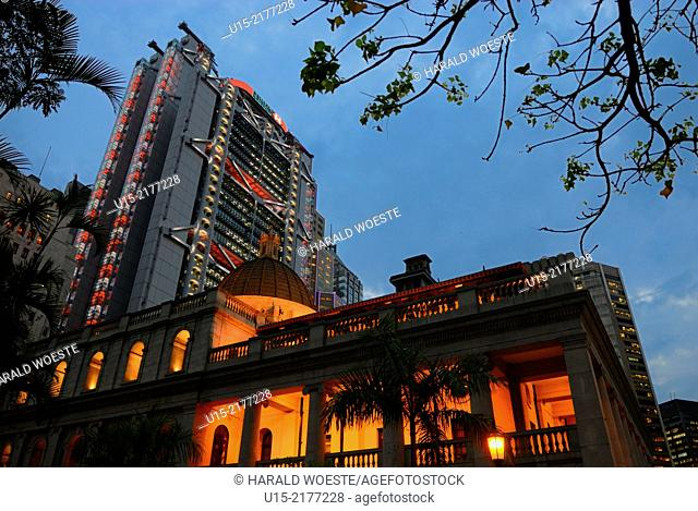 Hong Kong, China, Asia. Hong Kong Central. The luminous HSBC bank tower behind the illuminated old building of the Legislative Council