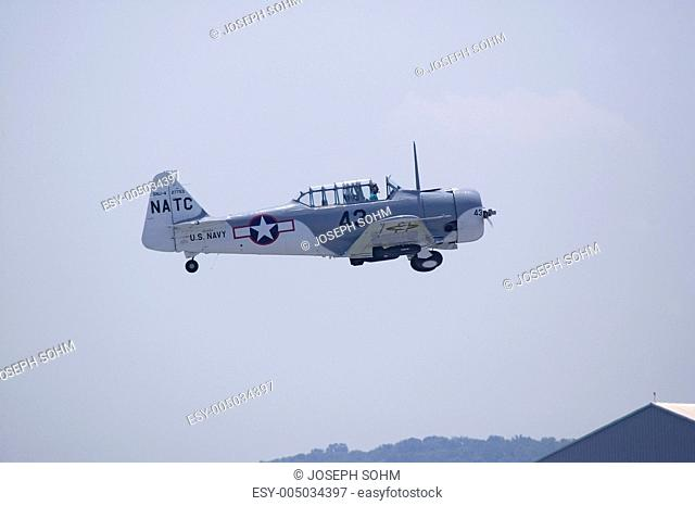 North American SNJ-4  SNJ-6 fighter plane from World War II, flying at Mid-Atlantic Air Museum World War II Weekend and Reenactment in Reading, PA held June 18