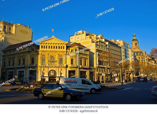 Traffic in front of Teatro de la Comedia theatre on Gran Via de les Corts Catalanes street Barcelona Catalunya Spain Europe