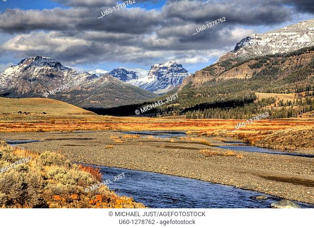 Soda Butte Creek flows before the Absaroka Mountain Range during the autumn at Yellowstone National Park, Wyoming