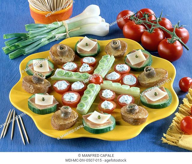 Petits fours - Cherry tomatoes and cheese - Potatoes and anchovies - Cucumber, country ham and cheese - Cucumber and onion