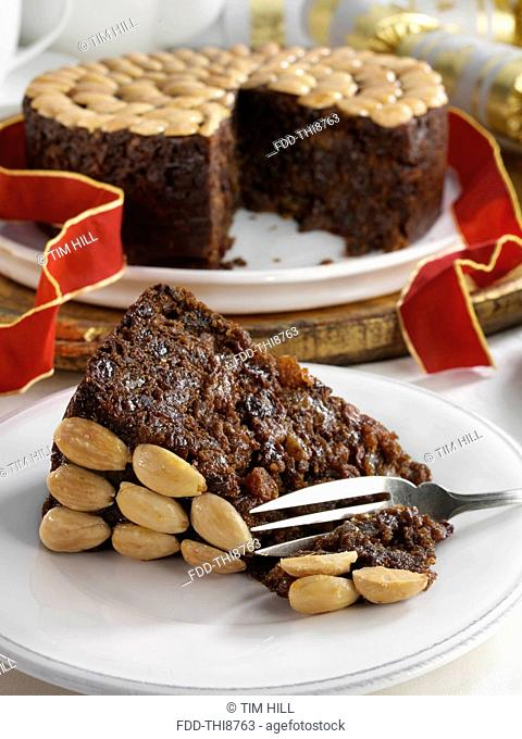 UK Christmas cake with a slice in front