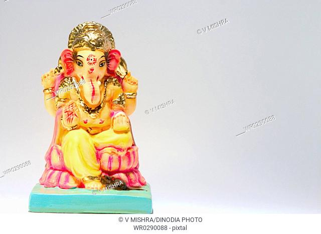 Celebration of Ganesh Chaturthi Elephant headed god one clay Idol on white background