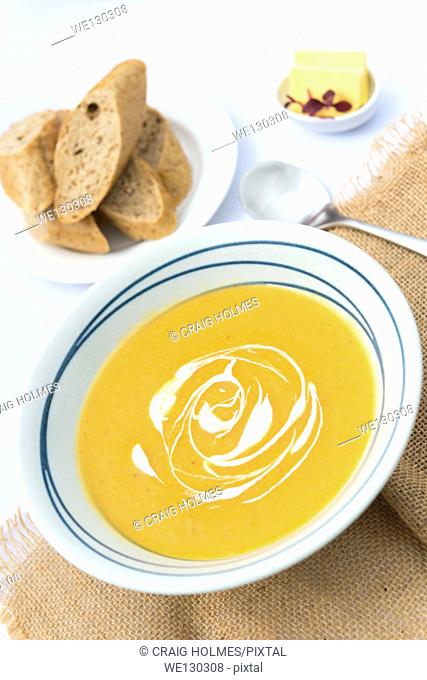 Butternut squash soup served with bread