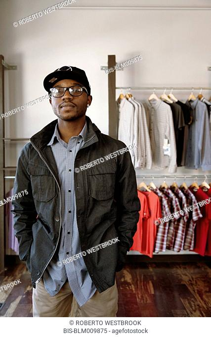 African American man standing in clothing store