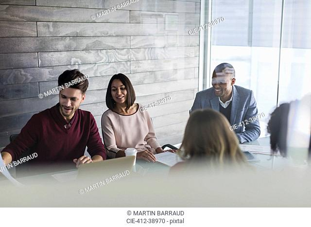 Smiling business people planning in conference room meeting