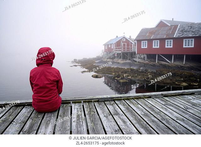 Norway, Nordland, Lofoten islands, Moskenesoy island, the fishing village of Reine, traditional fishermen cabins built on stilts (rorbu, rorbuer) in the fog