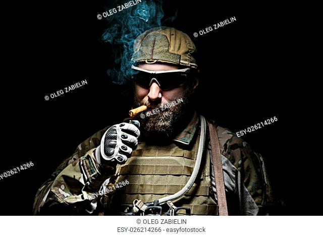 Green Berets US Army Special Forces Group soldier smoking