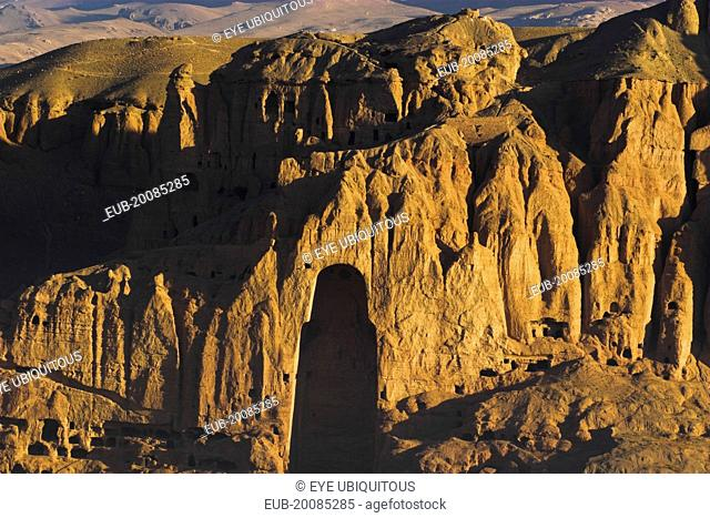 View of Bamiyan valley showing cliffs with empty niche where the famous carved Budda once stood (destroyed by the Taliban in 2001)