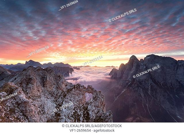 The heart shaped arch of stone in the Pale of the Balconies, Pala group, Dolomites. Europe, Italy, Veneto, Agordino, Belluno