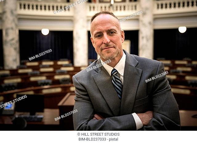 Caucasian politician posing in rotunda