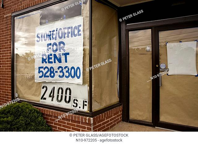 Signs on building reading, 'Store/Office For Rent'