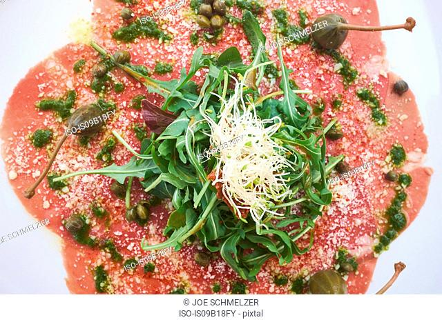 Summer dish of carpaccio, rocket leaves and capers