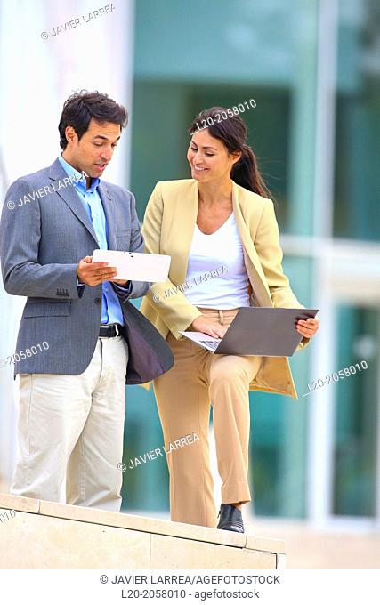 Businesswoman and businessman in business center. San Sebastian Technology Park. Donostia. Gipuzkoa. Basque Country. Spain