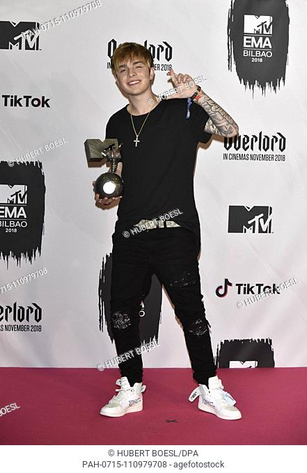 Best German Act winner Mike Singer poses in the press room of the 2018 MTV EMAs, Europe Music Awards, at Bizkaia Arena in Bilbao Exhibition Centre (BEC) in...