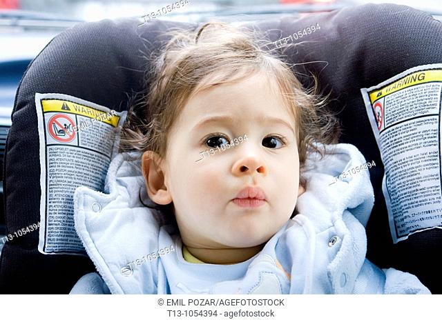 Eight month old infant boy in a car portrait