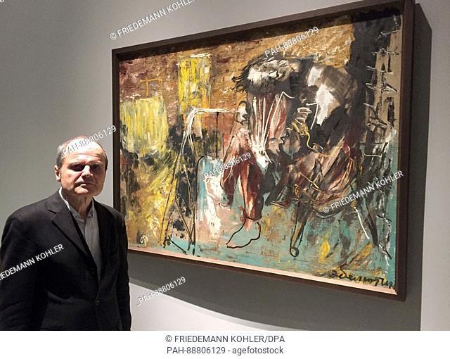"""Berlin art historian Eckhart Gillen standing next to the painting """"""""Three months after the war"""""""" by Eli Belyutin of the Soviet Union 1945"""