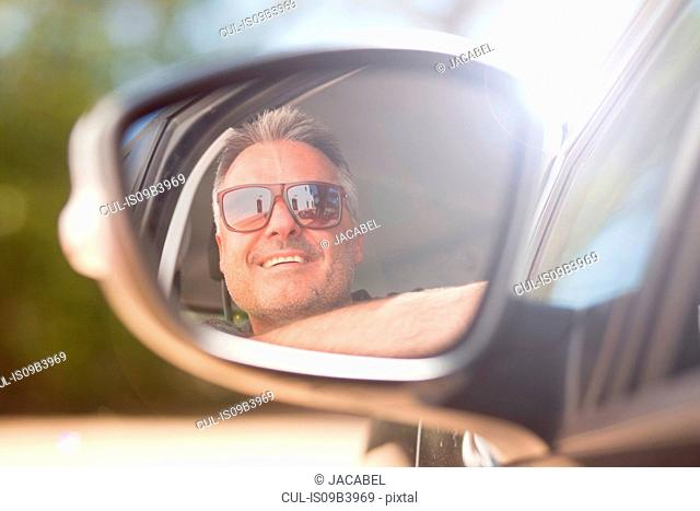 Man looking out of car window