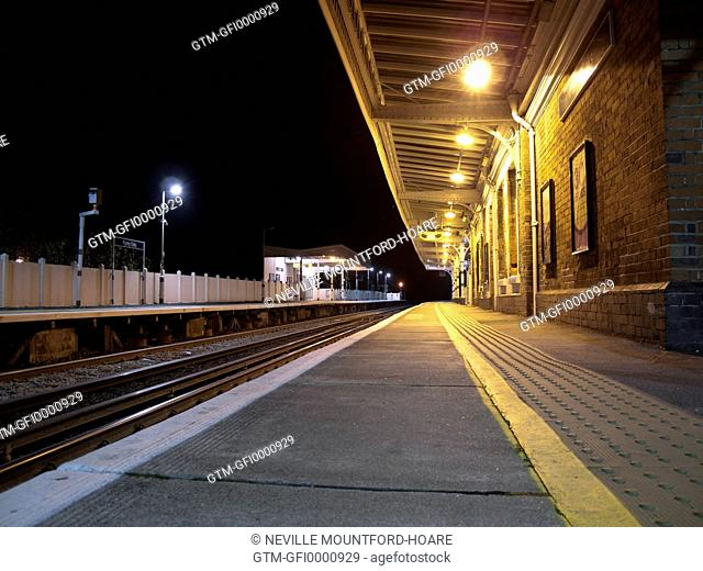 Empty station platform at night