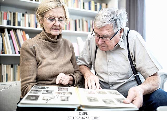 Senior couple looking at photo album