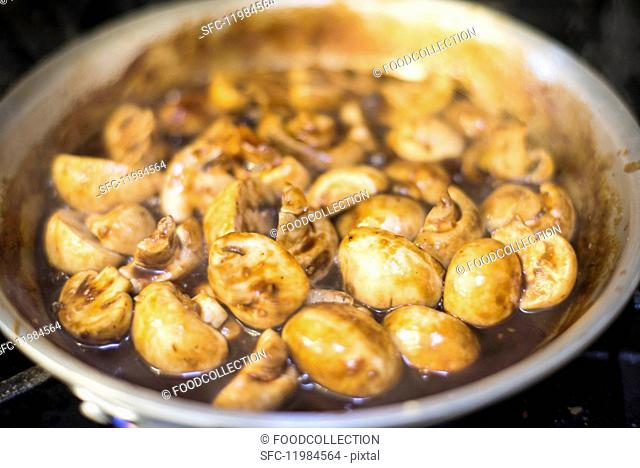 Braised mushrooms in a frying pan