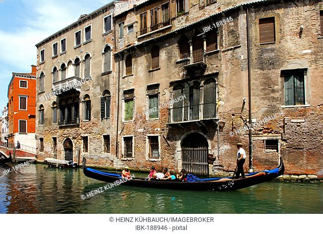 A gondola passing by some old buildings, Venice, Veneto, Italy