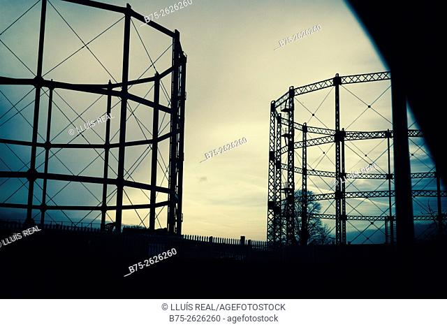 Evening view of two gas holders. Skipton, Yorkshire, England, UK, Europe