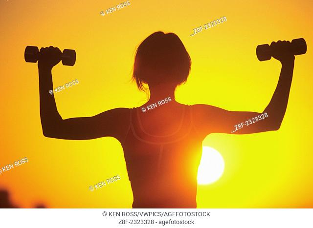 Silhouette of Woman with Dumbbells, Model Released