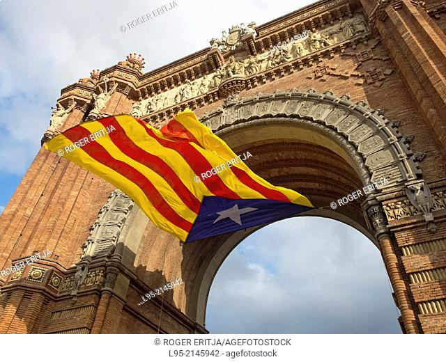Catalan independentist flag in the Triumph Arch at a nationalist festival, Barcelona, Spain