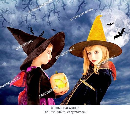 Halloween kid girls and pumpkin in moon sky